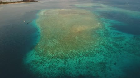 atol : Aerial view coral reef, atoll with turquoise water in the sea.Tropical atoll, coral reef in ocean waters. 4K video. Travel concept. Aerial footage. Stock Footage