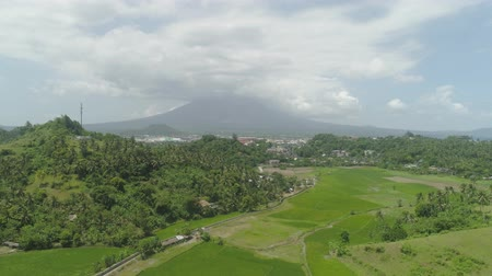 legazpi : Aerial view city Legazpi in background Mayon volcano. Tropical landscape city near volcano on seashore, Philippines, Luzon. Stock Footage