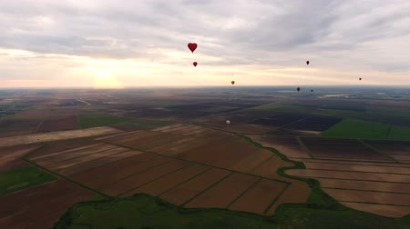 tej : Aerial view:Hot air balloons in the sky over a field in the countryside in the beautiful sky and sunset.Aerostat fly in the countryside.
