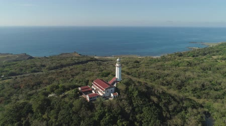 farol : Aerial view of Lighthouse on hill. Cape Bojeador Lighthouse, Burgos, Ilocos Norte, Philippines. Stock Footage