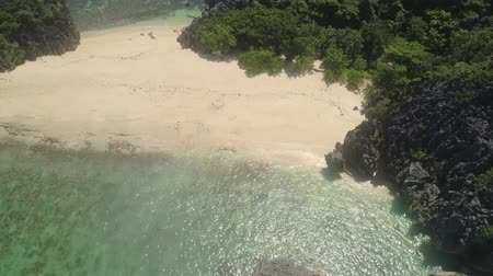 luzon : Aerial view islands with sand beach Lahus and turquoise water in blue lagoon among coral reefs, Caramoan Islands, Philippines. Landscape with sea, tropical beach.