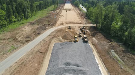 maintenance : Construction of toll roads in rural areas. Aerial view construction of a new highway next to the old highway.