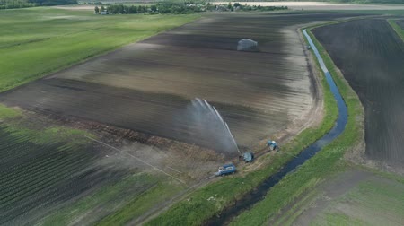 irrigation system : Aerial view of Crop Irrigation using the center pivot sprinkler system. An irrigation pivot watering agricultural land. Irrigation system watering farm land.