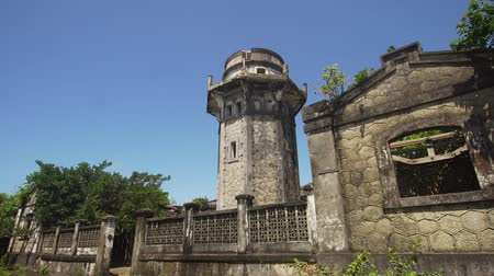 history : lighthouse in Palau island. Lighthouse in cape Engano against blue sky, province of Cagayan, Philippines.