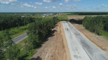 maquinaria : Construction of toll roads in rural areas. Aerial view construction of a new highway next to the old highway.