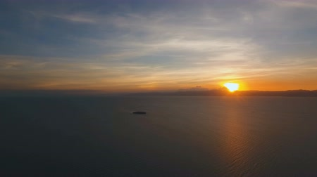 cebu : Marine tropical sunset over the sea. Aerial view: Sunset over the sea in the background orange sky and islands. Fly over the ocean in sunset time. Travel concept. Nothing but sky, clouds and water. Beautiful serene scene. Tropical landscape. Philippines,  Stock Footage