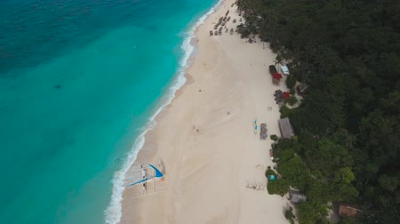 boracay : aerial footage beautiful beach with white sand and palm trees on tropical island. Beach with blue lagoon Travel concept
