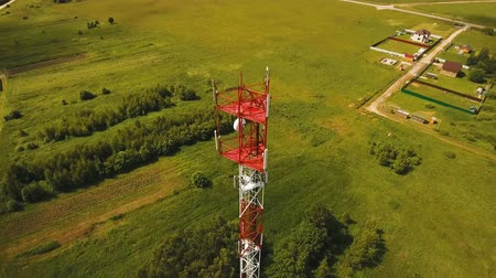 сигнал : Aerial view Cell phone tower. Tower of communications with lot of different antennas. Telecommunication tower. Aerial footage, 4K video