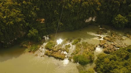 zipline : aerial footage people using the zipline attraction over river Loboc .People doing zip line Bohol, Philippines Travel concept. Aerial footage.