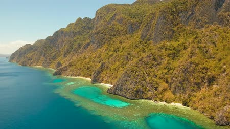 palawan : Aerial tropical lagoon with azure water and coral reef among rocks with tropical vegetation, Palawan, Philippines Travel concept, Aerial footage.