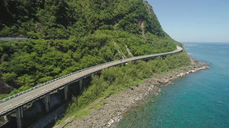 luzon : Aerial view of Patapat viaduct in the coast of Pagudpud, Ilocos Norte. Highway with bridge by coast sea near the mountains. Philippines, Luzon.