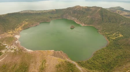 philippine : aerial footage lake crater at taal Volcano Luzon Philippines. Volcano with crater on an island in middle lake. Travel concept. Aerial video.