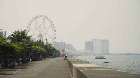 sokak : Quay near the Mall of Asia. Panorama Manila city, skyscrapers and buildings. Seascape coastal city of Manila. Modern city by sea. Makati district. Travel concept.