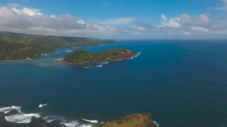 filipíny : aerial footage coast line of tropical island with mountains and rainforest ocean with big waves Catanduanes. sea and the tropical island with rocks, beach and waves. Philippines. Travel concept Aerial footage Dostupné videozáznamy