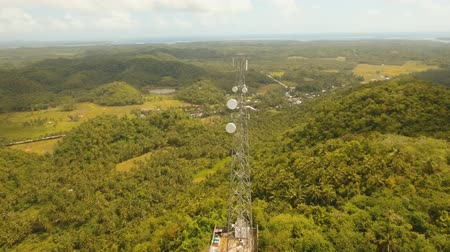 vysílač : aerial footage telecommunication tower located located in mountainous province. cellphone tower in rainforest white telecom radio tower