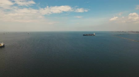 freighter : aerial footage freight and merchant ships in bay Manila container ship in sea Philippines Stock Footage