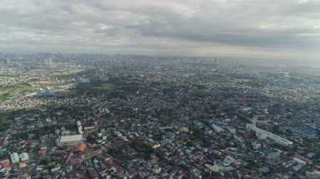 estrutura construída : Aerial view of Manila city with skyscrapers and buildings. Philippines, Luzon. Aerial skyline of Manila. Vídeos