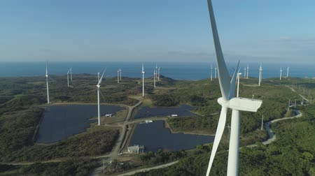 filipíny : Aerial view of Windmills for electric power production on the seashore. Bangui Windmills in Ilocos Norte, Philippines. Solar farm, Solar power station. Ecological landscape: Windmills, sea, mountains. Pagudpud. Dostupné videozáznamy