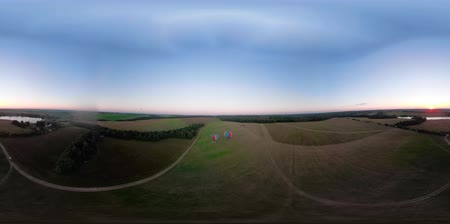 vzducholoď : VR360 Hot air balloon in the sky over field in the countryside in the beautiful sky and sunset. Aerial view Aerostat fly in countryside. Dostupné videozáznamy