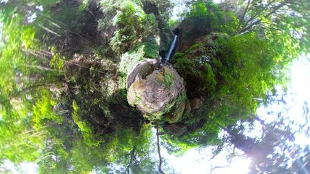 сферический : little planet view waterfall in green rainforest. tropical waterfall in mountain jungle. Bali,Indonesia. Travel concept.