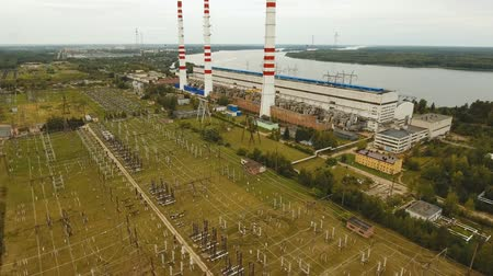 絶縁 : Aerial view Hydroelectric power station, transformation station, cables and wires. High voltage electric power substation. Electrical power transformer in high voltage substation, 4K, aerial footage. 動画素材
