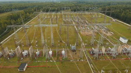 絶縁 : Aerial view Power plant, transformation station, cables and wires. High voltage electric power substation. Electrical power transformer in high voltage substation, 4K, aerial footage.