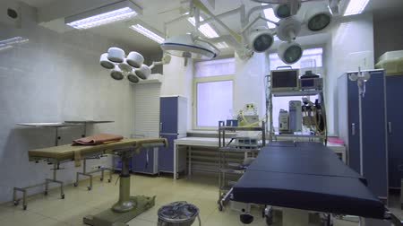 surgical equipment : Operating room at hospital with equipment and medical devices. Table for surgical operations in the hospital. Interior of operating room in modern clinic.
