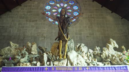 crucified : Christ on the Cross in the Interior of Church of St. Mary the Virgin. Sagada, Philippines.