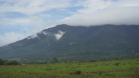 luzon : Mountain valley near mount Isarog. Mount with green tropical rainforest, trees, jungle with sky. Philippines, Luzon. Tropical landscape
