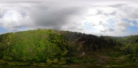 dron : vr360 tropical landscape mountains covered with rainforest and green vegetation. Aerial view farmlands, village, fields with crops, trees. Bali, Indonesia.