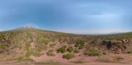 valley of fire : vr360 landscape mountains slopes volcano with fire, farmland at foot of the volcano Agung Aerial view of Mountains are covered with forest. Bali, Indonesia.
