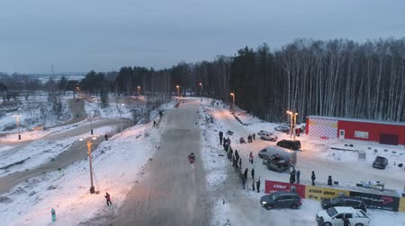 pista de corridas : Russia, Championship on snowmobiles January 27, 2018: Winter racing on snowmobiles. Aerial view: Action from snowmobile races.