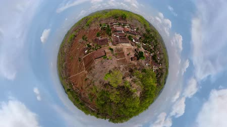 küresel : little planet view agricultural land in rural areas with farmlands, fields with crops, trees. aerial view growing crops in asia in hilly areas Indonesia.