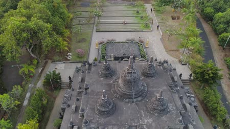 место поклонения : buddhist temple Brahma Vihara Arama with statues gods. aerial view balinese temple, old hindu architecture, Bali architecture, ancient design. Travel concept. indonesia Стоковые видеозаписи