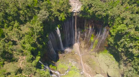 java : aerial view waterfall coban sewu in Java, indonesia. waterfall in tropical forest by drone Tumpak Sewu aerial footage