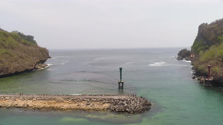 dalgakıran : breakwater entrance fishing harbor. aerial view seascape with seaport breakwater and ocean