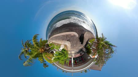 küresel : little planet view sea coast with tropical beach. surf, waves crushing on coral reef. Bali,Indonesia, travel concept.