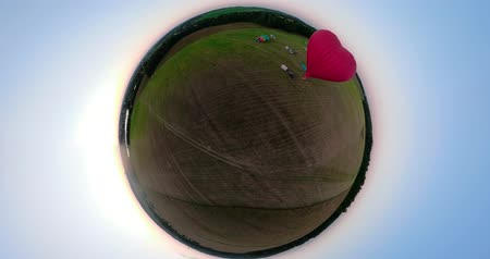 dirigível : Hot air balloons in sky over field in countryside beautiful sky and sunset Aerial spherical little planet view. aerostat fly in countryside.