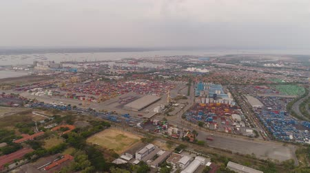 container terminal : aerial view container terminal port surabaya. cargo industrial port with containers, crane. Tanjung Perak, indonesia. logistic import export and transport industry Stock Footage