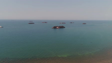 dragging : aerial view barges full coal anchored at sea near coal fired power station waiting be transported. coal barges and tugboats java, paiton indonesia Stock Footage