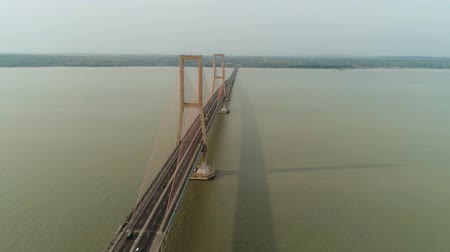 ponte sospeso : suspension bridge over madura strait with highway and car, surabaya. aerial view bridge Suramadu connecting islands Java and Madura. High coast bridge with highway.java, indonesia