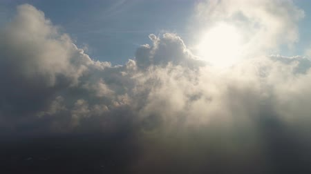 ışınları : aerial view sky with clouds and sun rays. cloudscape view over white fluffy clouds. aerial landscape