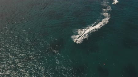 jet ski : aerial view water sports and recreation on tropical island, jet ski, boat. Philippines Boracay, aerial footage Stock Footage