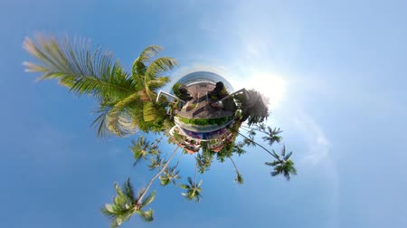 сферический : little planet view modern hotel with villas, palm trees in tropical resort by sea. tropical resort with pool travel concept.