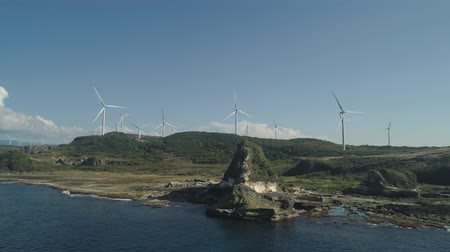 石灰岩 : Natural rock formation of limestone stone on coast with windmills for electric power production. Aerial view of tourist attraction Kapurpurawan Rock Formation in Ilocos Norte Philippines,Luzon.
