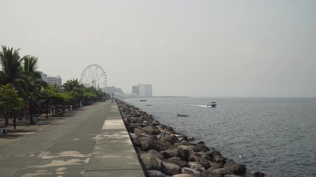 luzon : Quay near the Mall of Asia. Panorama Manila city, skyscrapers and buildings. Seascape coastal city of Manila. Modern city by sea. Makati district. Travel concept.
