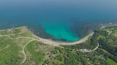 luzon : Aerial view beach, lagoon and coral reefs. Philippines, Pagudpud. Ocean coastline with turquoise water. Tropical landscape in Asia.
