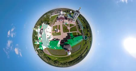 сферический : Architectural historical Christian monastery with church surrounded by stone walls aerial spherical little planet view. Domes of the church with crosses