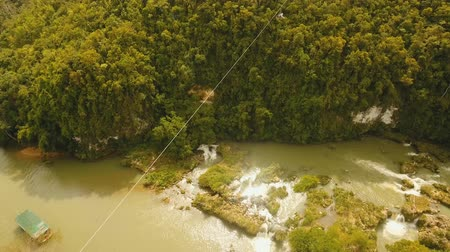 zip line : aerial view people using zipline attraction over river Loboc. People doing zip line Bohol, Philippines Travel concept. Aerial footage. Stock Footage