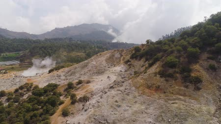 gejzír : plateau with volcanic activity, mud volcano Kawah Sikidang, geothermal activity and geysers. aerial view volcanic landscape Dieng Plateau, Indonesia. Famous tourist destination of Sikidang Crater it still generates thick sulfur fumes.